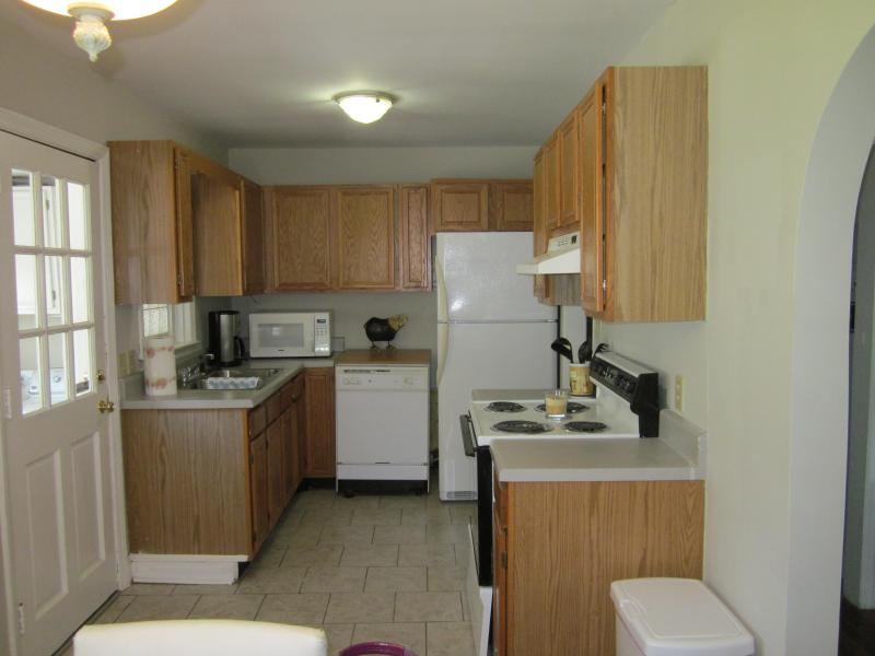 Fully stocked kitchen, Fridge w/ ice maker, dishwasher, stove & microwave.