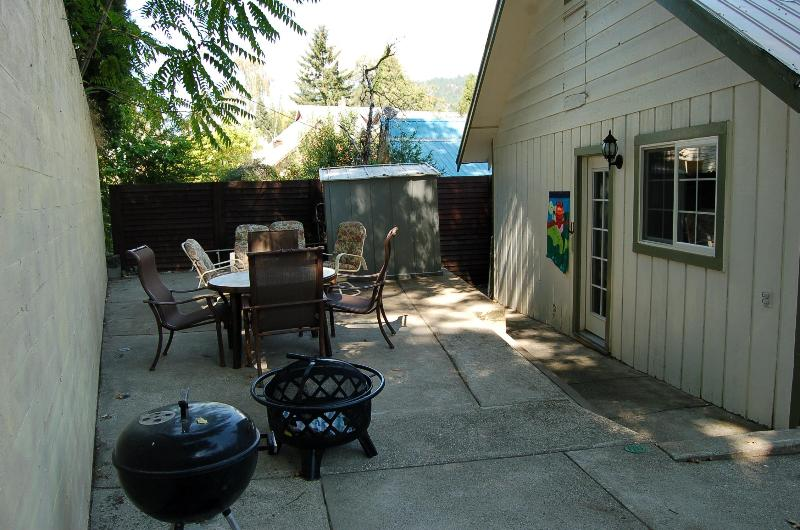 Shady, private patio with fire pit, BBQ, nice seating, dining set