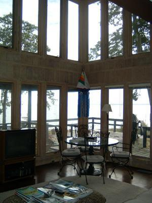 Two-story living room faces the water