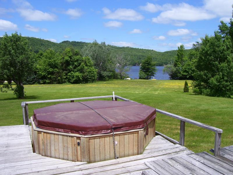 view of the lake-hot tub from Farm