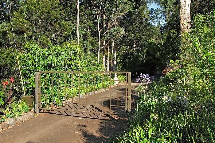 The gated entrance to our 5 acre private estate - home to Aloha Cottage and Thai Tree House.