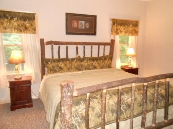 King Size Bed in the Master Bedroom on the Main Floor