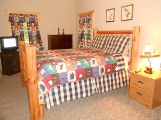 Queen size bed in the Second Bedroom with Flat screen TV. On the Main Floor