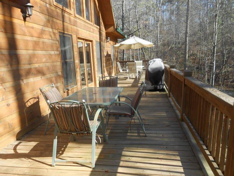 Upper Deck off the Main Floor with 2 patio tables and chairs