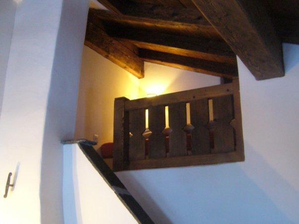 Mezzanine up stone steps with large single bed