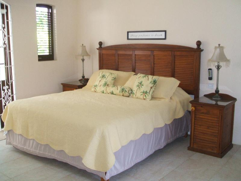 King Sized bed with gorgeous linens