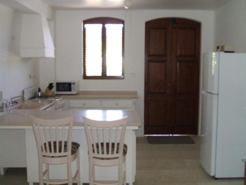 Kitchen and indoor eating area, view 1