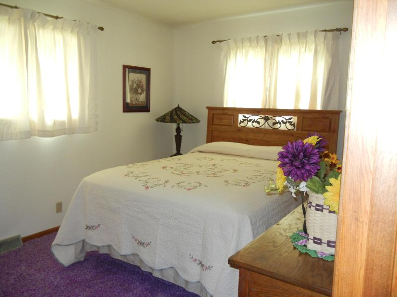 One of the upstairs bedrooms with queen bed