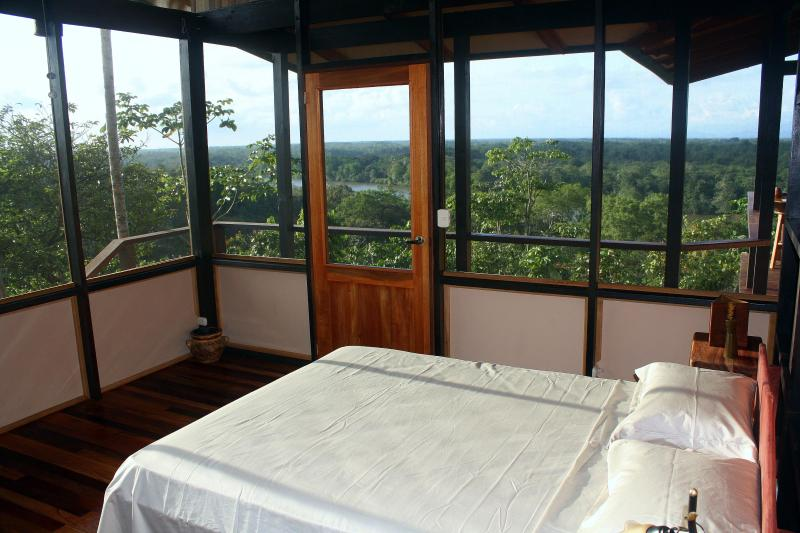 Bedroom #2 has views of the river, mountains, and attached bath