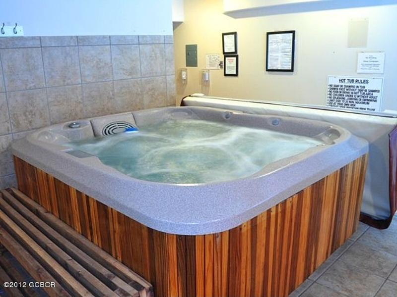Large hot tub - Steps from condo, great river views