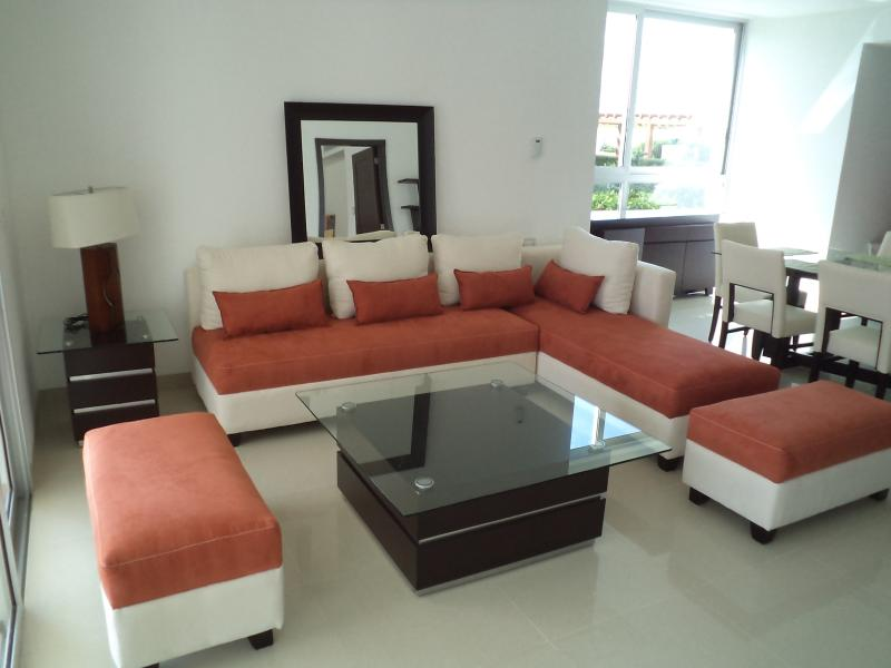 Living area next to dining room...opens to terrace and gardens..