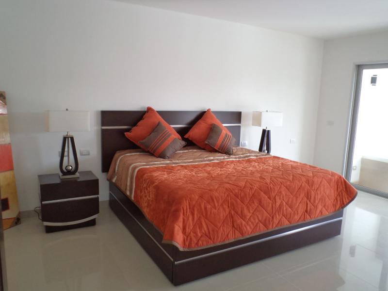 Master Bedroom....contemporary decor throughout condo...