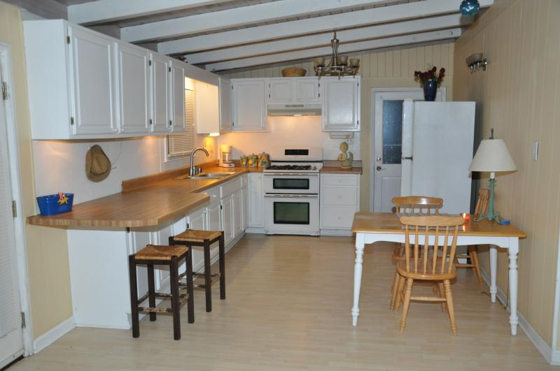 Kitchen with gas stove, full sz Fridge and extra deep sink.
