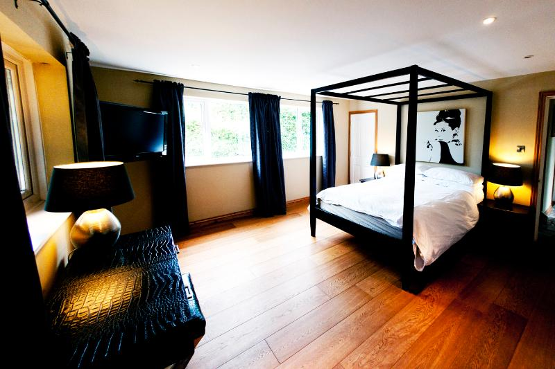 Master Bedroom with luxury four poster bed and widescreen TV