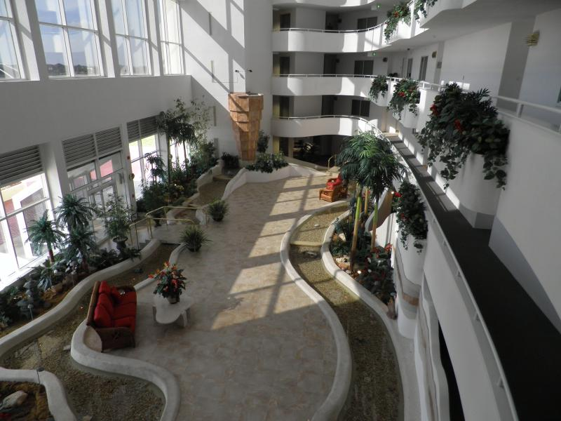 Ride elevator to 3rd floor and view Atrium as you walk to the condo