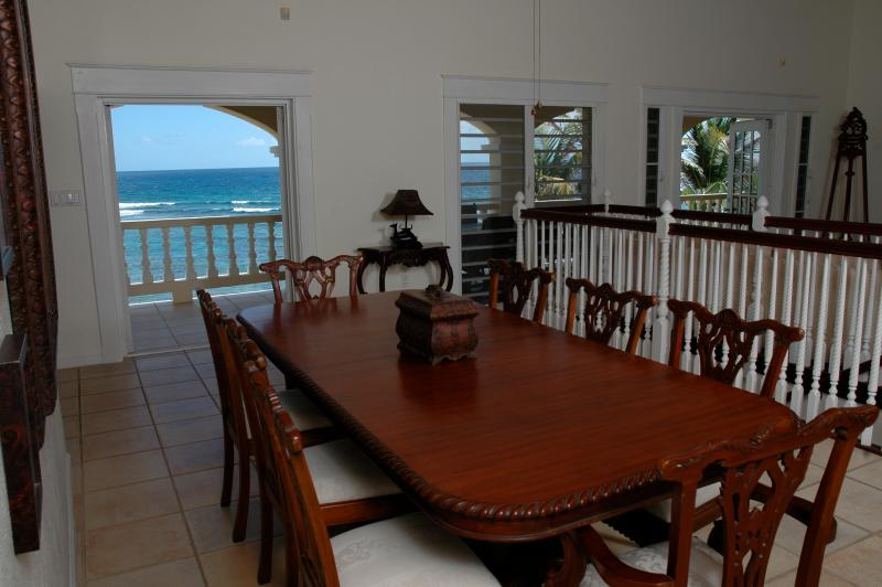 The formal dining room seats 8 comfortably and overlooks the sea at Paradise Point, St. Croix, USVI.