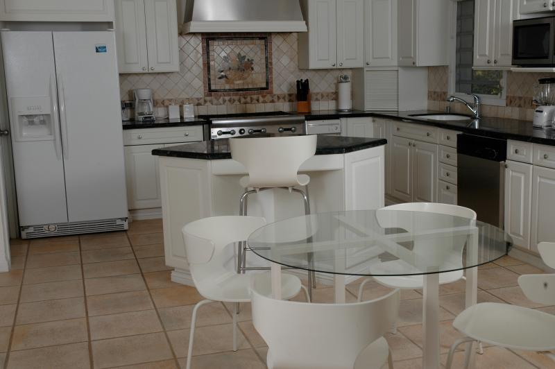 The gourmet kitchen is well equipped with a Sub-Zero refrigerator and restaurant range.
