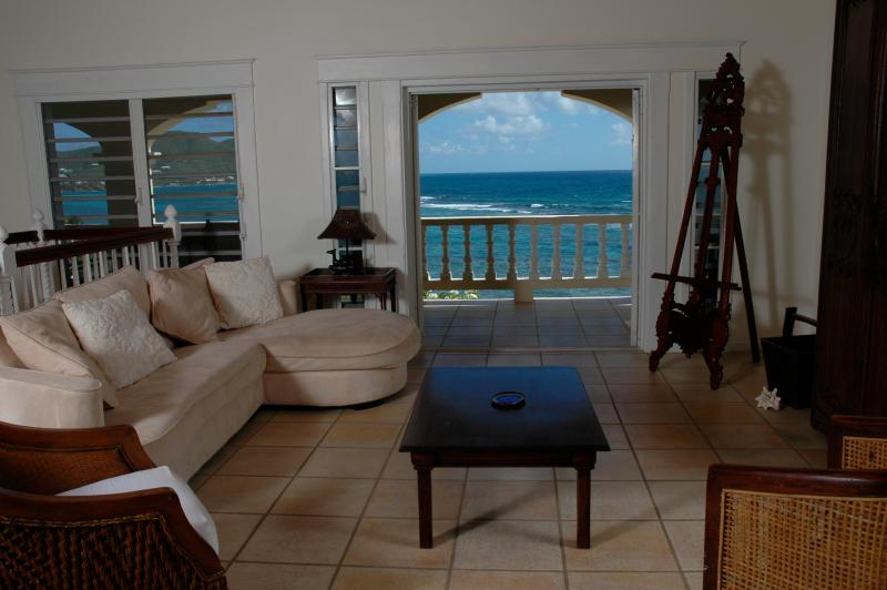 Relax inside the art-filled great room at Paradise Point, St. Croix, USVI
