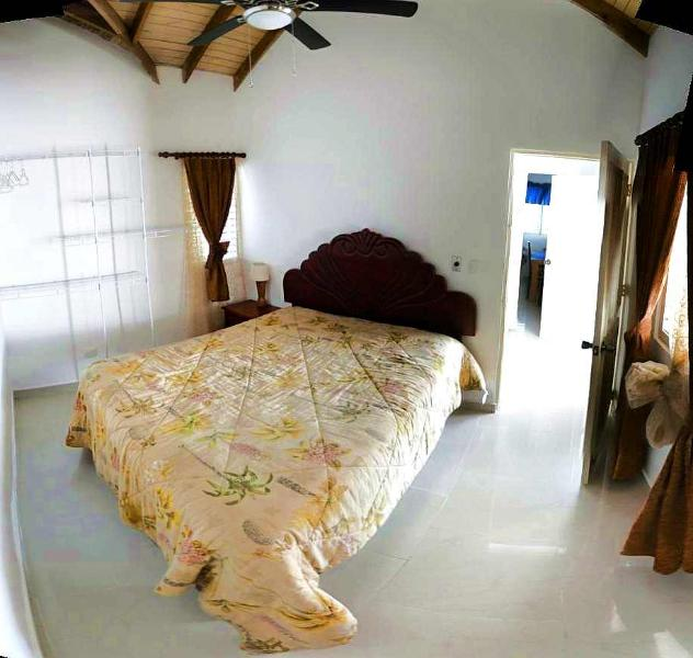Bedroom with queen size bed and ceiling fan
