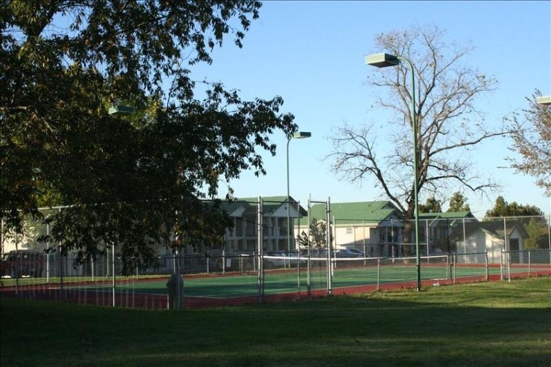 Tennis court next to the pool