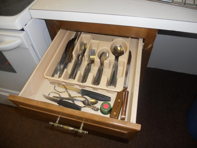 Drawer 1 of 3 with utensils