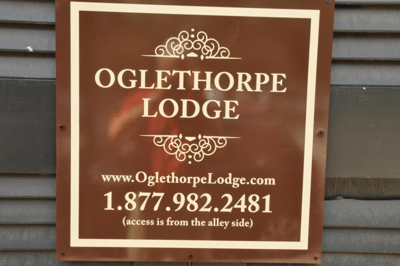 Sign on the non-entrance street side of the Lodge.