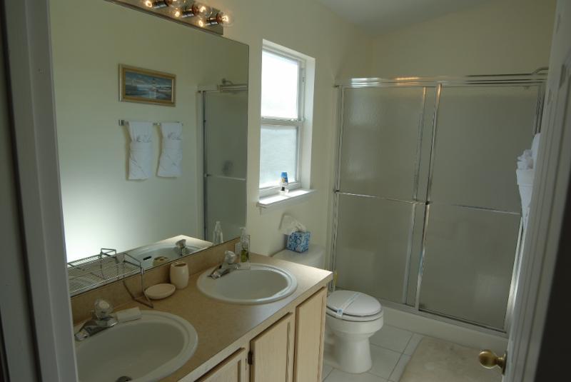 Master Bathroom corner seats plus shower chair if needed