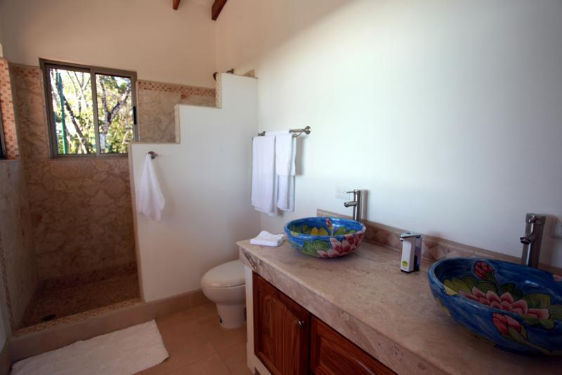 The master bath; windows in the shower provide a glorious view of the ocean!