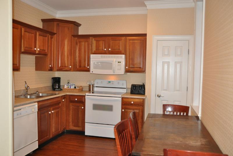Kitchen includes basic utensils, coffee maker and small stock of coffee.