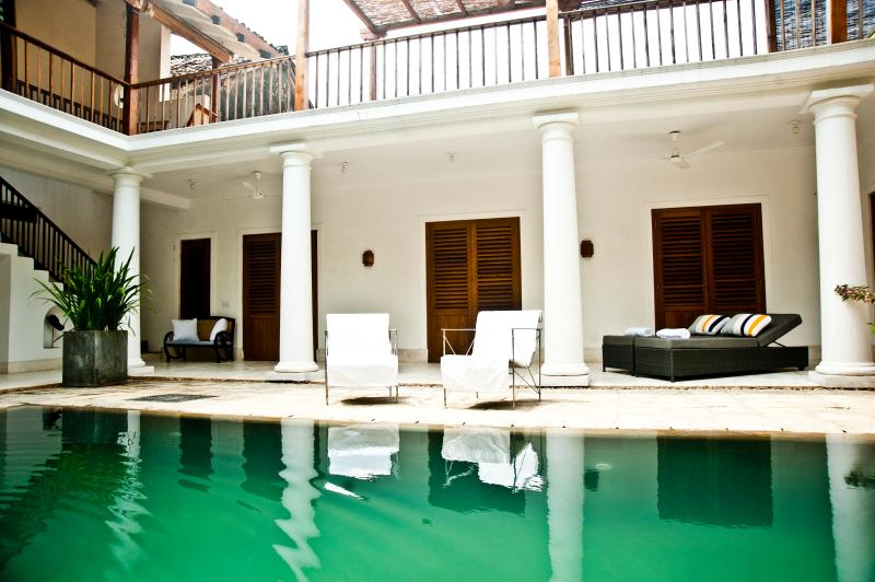 view of pool and sun loungers