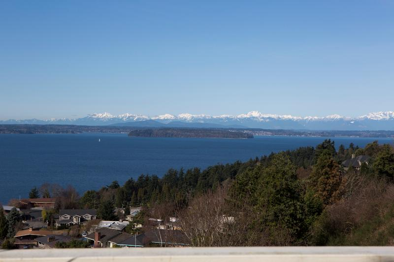 Gorgeous view of the Puget Sound, Olympics and Ferry from the large, expansive back view deck