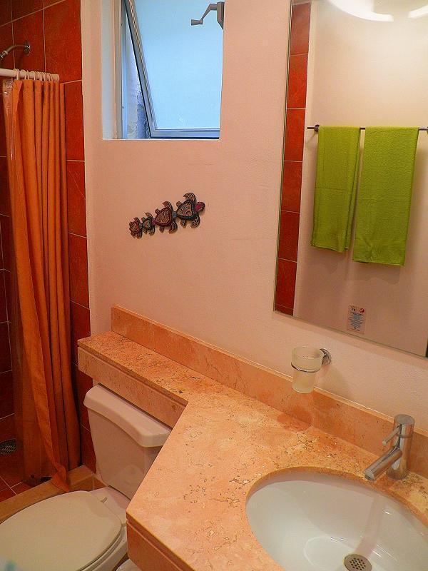 vanity in bathroom in second bedroom