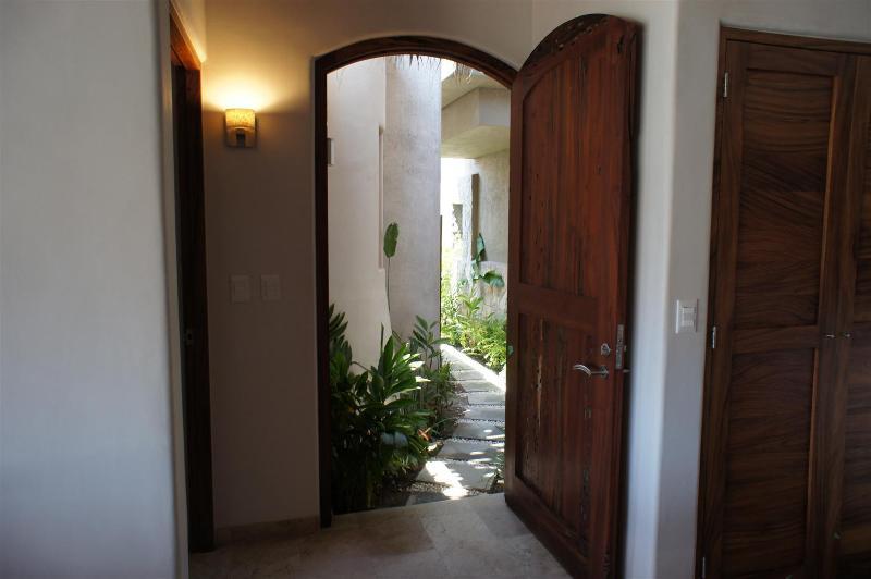 Welcome to Casa Ziesta. Entry door is made from reclaimed Parota worm wood.