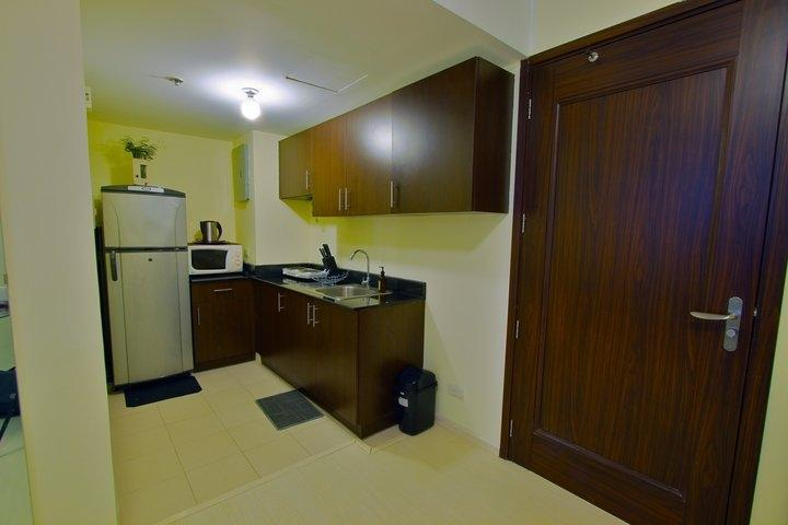 kitchen with basic cooking amenities wares, brand new refrigerator