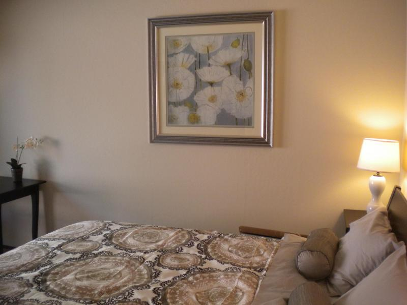 Super comfortable and spacious bedroom with queen size bed overlooks private sunny patio.