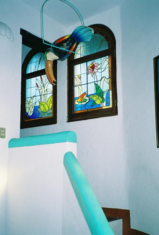 Charming Stained Glass Windows off the Spiral Staircase