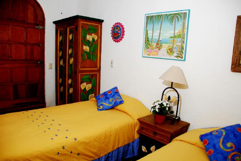 Entrance level bedroom has two twin beds which, upon request, can be converted into a kingsize bed