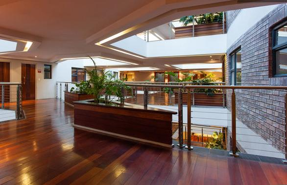 Lovely wood detail and a 7-floor atrium inside The Rockwell