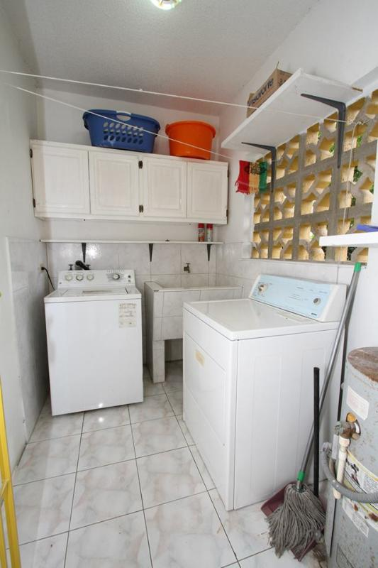 Laundry Room: Washer/Dryer and Sink