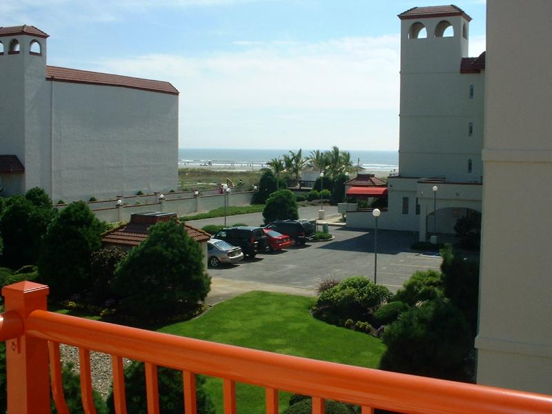 View of beach from deck in living room