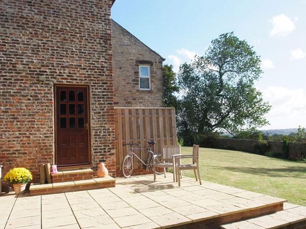 Riding Farm Cottage 4 Star Gold terras en tuin een echte zonvlek
