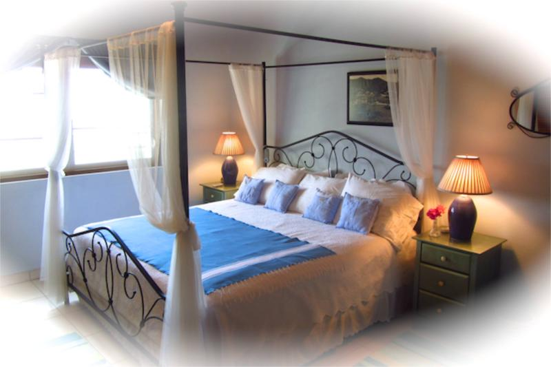Master Bedroom with Sleep Number King Bed with personal air-conditioner.  Window with an ocean view.