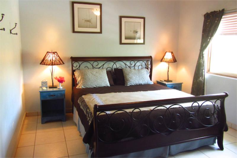 Guest Bedroom with King Sleep Number Bed, Personal air-conditioner  and a large window.