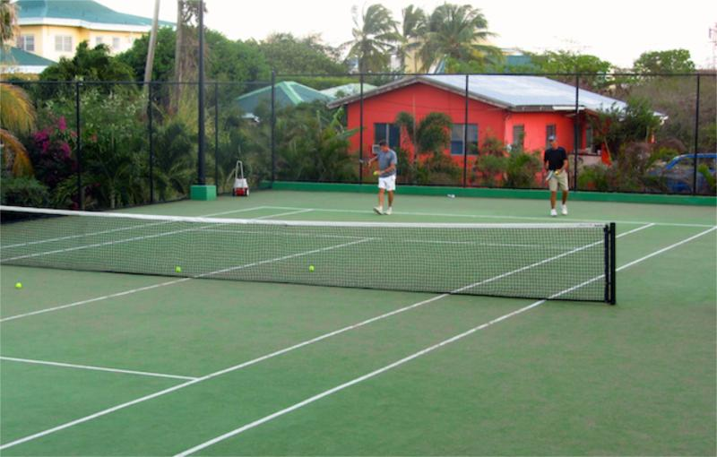 Two tennis courts with lights for evening play