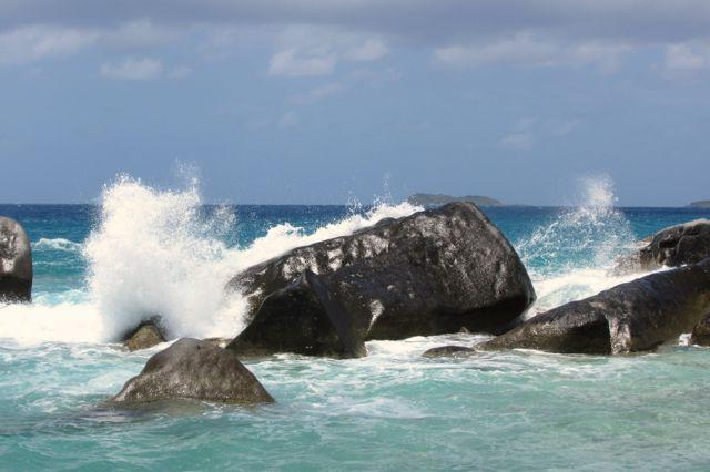 Waves splashing over the boulders