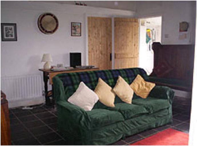 sitting room with Jotul woodburning stove