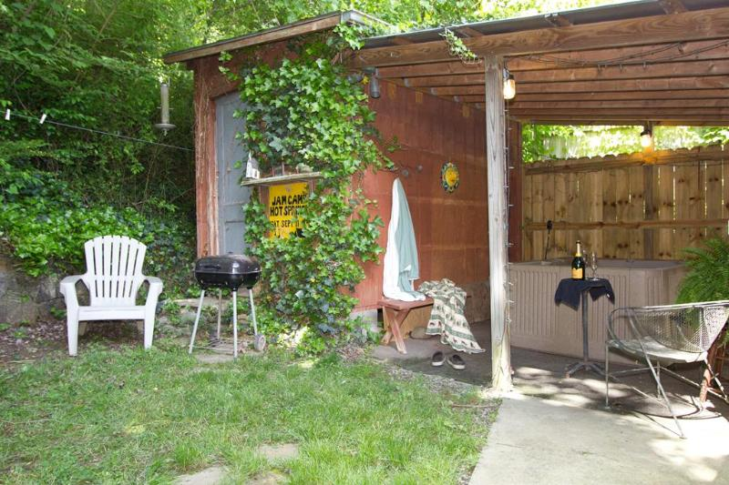 Private outdoor hot tub, steps outside your back door.  Charcoal grill, private garden.