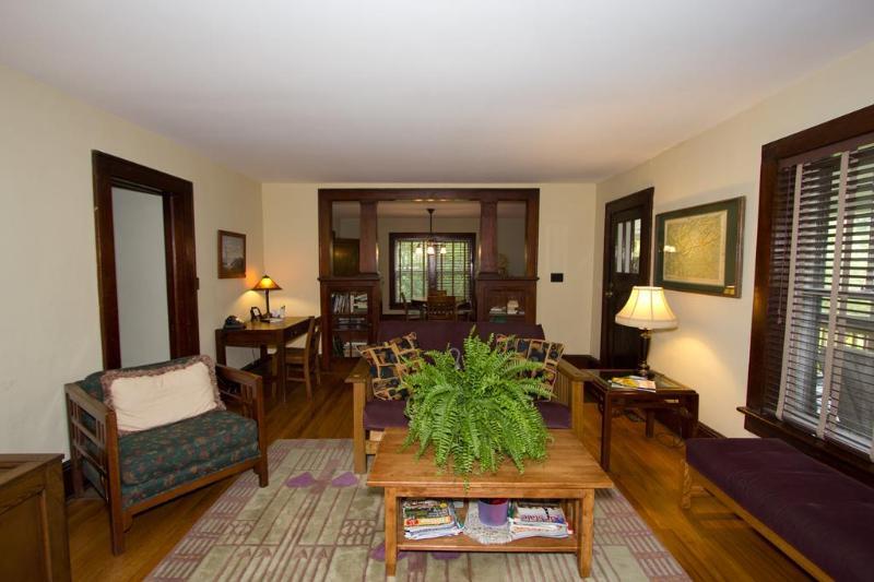 open living room/dining room. Original hardwood floors throughout, beautiful detailed woodwork