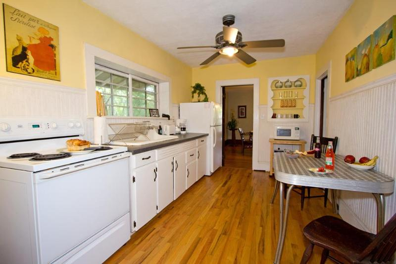 Vintage kitchen, original cabinets, full size fridge, coffeemaker, mw, range, toaster and 40's table