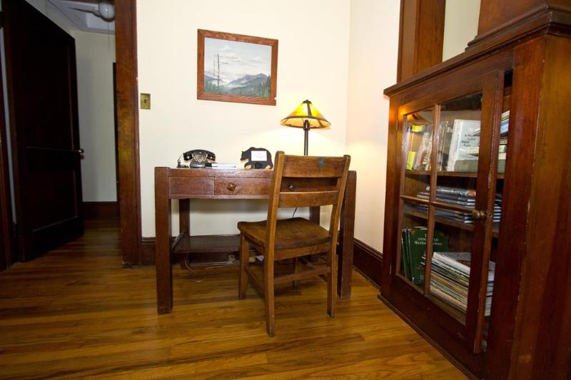Inviting entrance desk, do some old fashioned writing at a 1920's original desk.